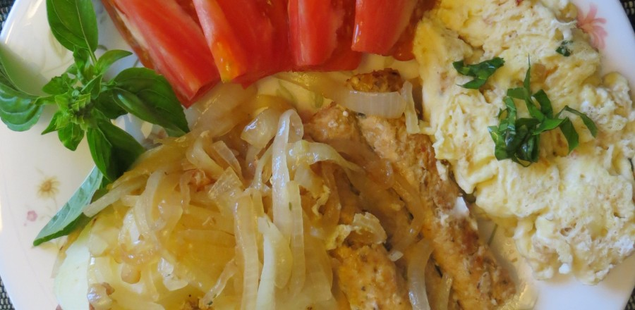 Organic chicken sausages with omelette, tomatoes and onions
