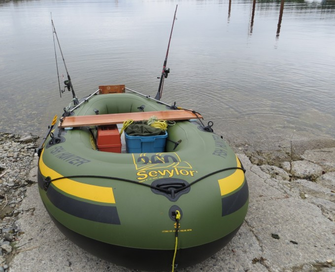 Inflatable boat being launched from nearby boat launch site