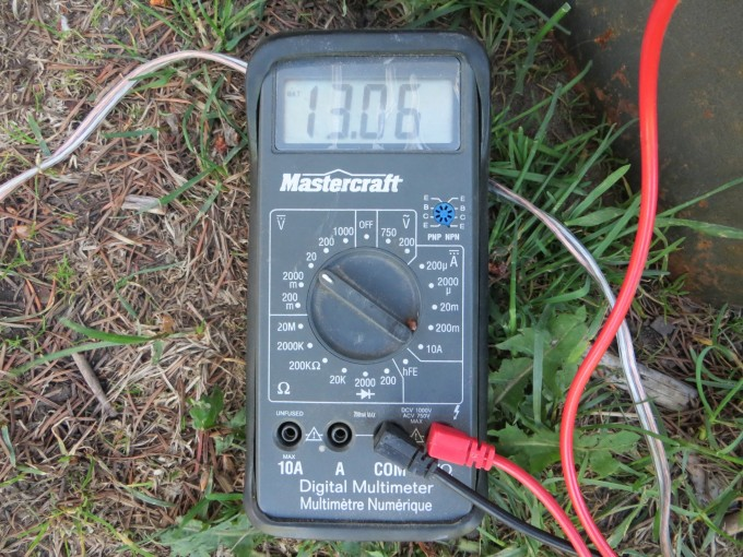 Multi meter measures voltage from solar panel to batteries