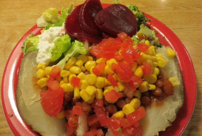 Canned beetroot with baked potato, beans & salad