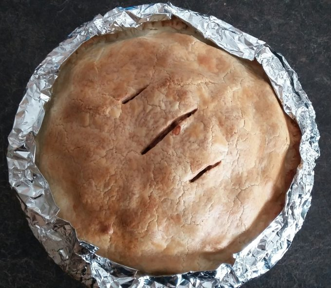 Baked apple pie with foil