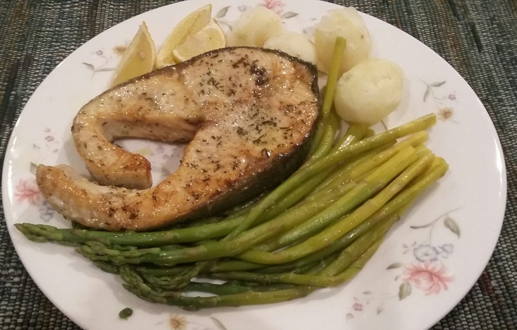Fresh salmon steak with asparagus